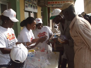 Volunteer Pharnacists giving out medication.